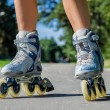 Close-up view of female legs in roller blades — Stock Photo #30560803