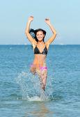 Attractive woman bathes at the sea — Stock Photo