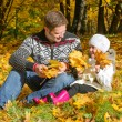 Man and little girl collecting leaves. — Stock Photo