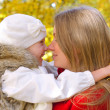 Little girl and her mother in the autumn park — Stock Photo