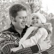 Stock Photo: Smiling father and daughter in park. Black and white