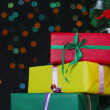 Stock Photo: Few gifts under christmas tree
