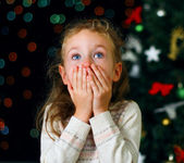Little girl over christmas decorations — Stock Photo
