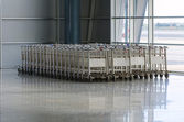 Luggage trolleys in airport terminal — Stock Photo