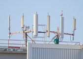 Six cellular towers on the roof — Stock Photo