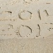 2013 replace 2014. Written on sand beach. — Stock Photo