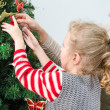 Little girl and her mother decorating the Christmas tree — Stock Photo