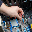 Hands of technician installing HDD on motherboard — Stock Photo