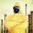 Man in chemical protective suit over factory — Stock Photo #35750637