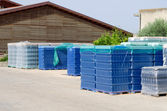Bottles for wine making at open air storage — Stock Photo