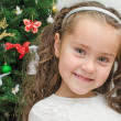 Happy little girl over christmas tree — Stock Photo
