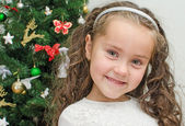 Happy little girl over christmas tree — Stok fotoğraf