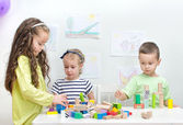 Children playing with blocks in kindergarten — Stock Photo