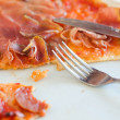 Closeup view of half pizza on a plate — Stock Photo