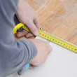 Male hands measuring and cutting gypsum plasterboard — Stock Photo #37443223