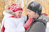 Happy father and daughter having fun in a winter park. — Stock Photo