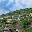 Houses in the green mountain hills. — Stock Photo
