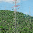 High voltage AC transmission towers. — Stockfoto