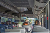 View from inside the bus with passengers. — Stock Photo