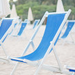 Stock Photo: Plenty of sun loungers on the beach