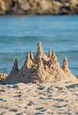 Sand castle on the beach. — Stock Photo