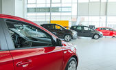 Several new cars at dealership salon. — Stock Photo