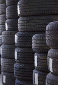 Used old car tires at workshop. — Stock Photo