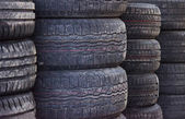 Used old car tires at workshop. — Stockfoto