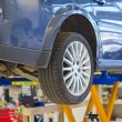 Car on lift in garage prepared for repair. — Stock Photo #45449925