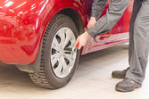 Mechanic fixing car wheel at service. — Stock Photo