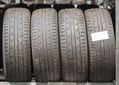 Used old car tires at warehouse. — Stock Photo