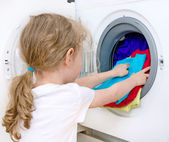 Little girl doing laundry. Housework concept. — Stok fotoğraf