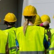 Group of workers in hardhats. View from the back. — Stock Photo #46881729