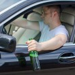Driving Under the Influence. Man drinking alcohol in the car. — Stock Photo