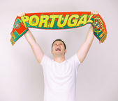 Man supports Portugal team with Portuguese scarf. — Stock Photo