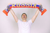 Man supports Russian team with Russian scarf. — Stock Photo