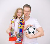 Father and daughter supports their sports team. — Stock Photo