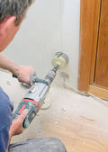 Man with Hammer drill doing hole for socket. — Stock Photo