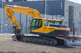 Excavator and bulldozer on construction site. — Stock Photo