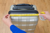 Hand luggage measurement using measuring tape. — Stock Photo