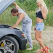 Man and woman near the broken car. — Stock Photo #51189141