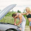 Man and woman near the broken car. — Stock Photo #51189145