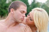 Sexy young couple kissing outdoors. — Stock Photo