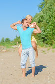 Happy young couple having fun on the beach. — Stock Photo
