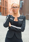 Young businesswoman in eyeglasses on the street. — Photo