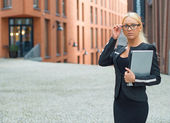Young businesswoman in eyeglasses with netbook. — Photo