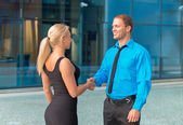 Business meeting. Man and woman shaking hands outdoors. — Stock Photo