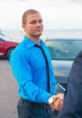 Businessmen shaking hands over a deal. — Stock Photo