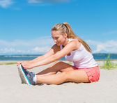 Young woman stretches before doing sports. — Stock Photo