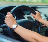 Woman's hand driving a car. Unrecognizable person. — Stock Photo